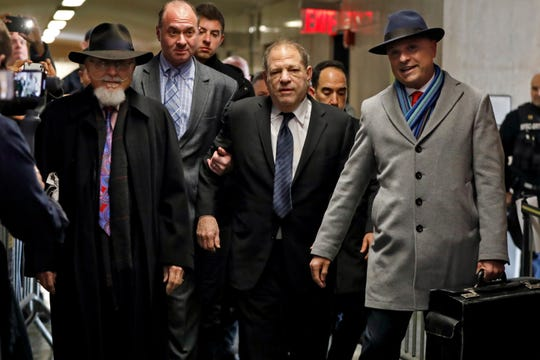 Harvey Weinstein, center, accompanied by attorney Arthur Aidala, right, arrives at court for his rape trial, in New York, Wednesday, Jan. 22, 2020.
