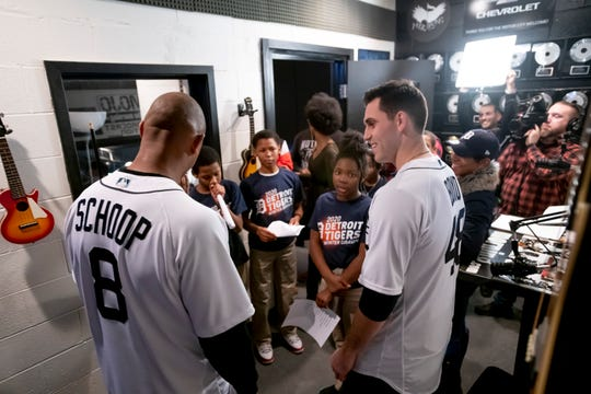 Detroit Tigers second baseman Jonathan Schoop, left, and pitcher Matthew Boyd chat with students at the Notes for Notes music program during the a stop of the Detroit Tigers winter caravan.