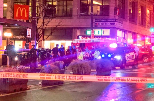 Police work the scene of a shooting on Third Avenue and Pine Street, Wednesday, Jan. 22, 2020, in Seattle.
