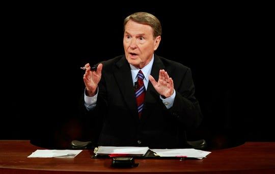 This Sept. 26, 2008 file photo shows debate moderator Jim Lehrer during the first U.S. Presidential Debate between presidential nominees Sen. John McCain, R-Ariz., and Sen. Barack Obama, D-Ill., at the University of Mississippi in Oxford, Miss.  PBS announced that PBS NewsHour's Jim Lehrer died Thursday, Jan. 23, 2020, at home. He was 85.