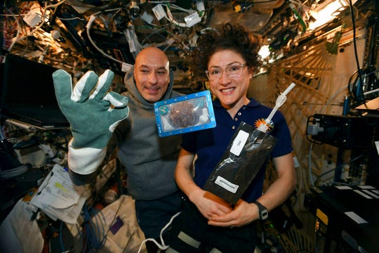 U.S. astronaut Christina Koch, who was born in Grand Rapids, posted via Twitter on Dec. 26, 2019, she and Italian astronaut Luca Parmitano pose for a photo with a cookie baked on the International Space Station.