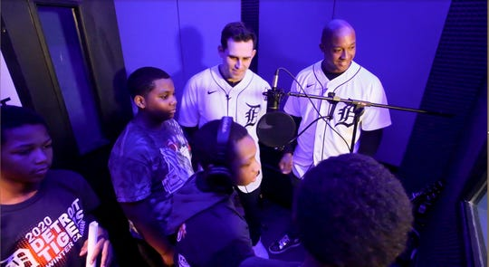 "Tigers pitcher Matthew Boyd, left, and second baseman Jonathan Schoop, listen to an updated version of ""Take Me Out To The Ballgame"" with students at the ""Notes for Notes"" music program during the a stop of the team's Winter Caravan at the S.A.Y. Detroit Play center in Detroit earlier this week."