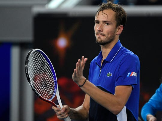 Russia's Daniil Medvedev celebrates after defeating Spain's Pedro Martinez in their second-round singles match Thursday at the Australian Open.