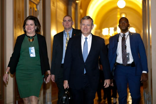 Supreme Court Chief Justice John Roberts, second from right, arrives at the U.S. Capitol in Washington for the impeachment trial of President Donald Trump on charges of abuse of power and obstruction of Congress, Thursday, Jan. 23, 2020.