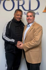 The Rev. Jessie Jackson and The Word Network owner  Kevin Adell.