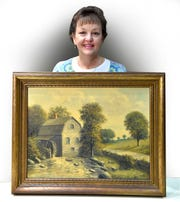 Marie Boussie  poses with an oil painting on canvass, possibly from the 1940s, by local Detroit artist E.A. Gates.