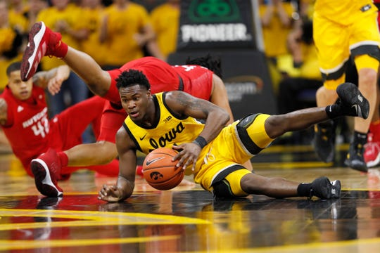 Iowa guard Joe Toussaint, fights for a loose ball with Rutgers guard Ron Harper Jr. during the second half.