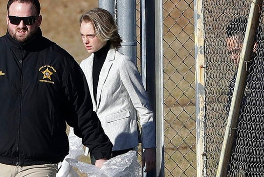 Michelle Carter leaves the Bristol County jail, Thursday, Jan. 23, 2020, in Dartmouth, Mass., after serving most of a 15-month manslaughter sentence for urging her suicidal boyfriend to kill himself in 2014.