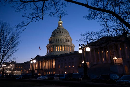 Night falls on the Capitol in Washington, Wednesday evening, Jan. 22, 2020, during the impeachment trial of President Donald Trump.