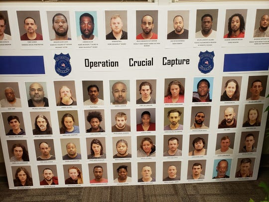 Warren police with help from federal agents arrested 50 people suspected of committing felonies.