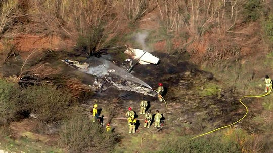 This photo taken from video provided by KTLA-TV shows the wreckage of a small plane after it crashed and burned at Corona, Calif., Municipal Airport Wednesday, Jan. 22, 2020.