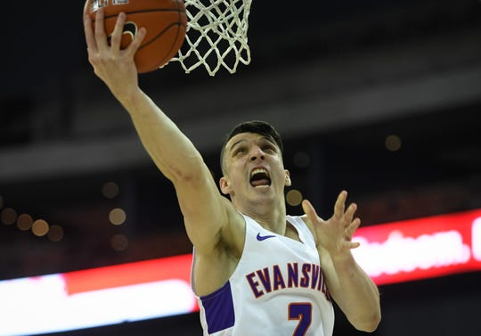 Evansville's Artur Labinowicz (2) shoots a second half layup as the University of Evansville Purple Aces play the Drake Bulldogs, the first game under new Aces head coach Todd Lickliter Wednesday afternoon at the Ford Center, January 22, 2020.