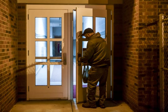 Tommy Garrett unlocks the doors at Evansville's Bosse High School and disables the building alarm, Thursday morning, Jan. 9, 2020. The outside maintenance man is the first person to arrive to the high school every morning.