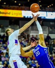 Evansville's Evan Kuhlman (10) and Drake's Jonah Jackson (20) battle for a rebound as the University of Evansville Purple Aces play the Drake Bulldogs, the first game under new Aces head coach Todd Lickliter Wednesday afternoon at the Ford Center, January 22, 2020.