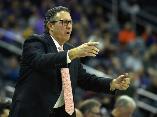 Coaching his first game as head coach, Todd Lickliter shouts instructions to the team as the University of Evansville Purple Aces play the Drake Bulldogs Wednesday afternoon at the Ford Center, January 22, 2020.