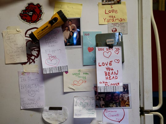 Love notes from Tommy Garrett's wife Martha Garrett and his granddaughter Breanna Garrett fill the old refrigerator in his office located on the side of Bosse High School's Enlow Field. He has been married to his wife for nearly 47 years.