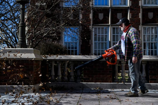 """Tommy Garrett blows the leaves away from the front of Evansville's Bosse High School to keep the grounds surrounding the school looking clean, Wednesday morning, Jan. 8, 2020. His official title at BHS is outside maintenance, but people around the school refer to him as """"Yardman Tommy"""""""
