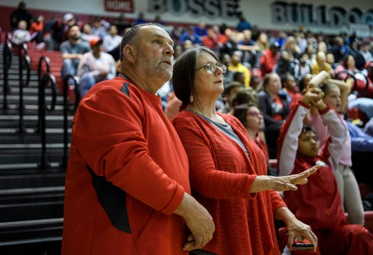 Tommy Garrett, left, and his wife Martha Garrett watch the Bosse Bulldogs battle the Castle Knights in triple-overtime during the first round of the SIAC tournament at BHS, Evansville, Wednesday evening, Jan. 15, 2020. Their granddaughter Breanna Garrett, not pictured, is on Bosse's varsity cheerleading team and they rarely miss a sporting event.