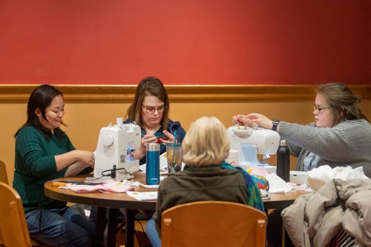 Good Samaritans, from left, Kaman Hillenburg, Samantha Ehrhart, Lisa Lutterbach, and Faith Connell do their part at the Crafting for a Cause: Austrailia Animal Rescue  workshop at Willard Library Tuesday afternoon, Jan. 21, 2020. Participants gathered to sew, cut and crochet specialty items like bat wraps, joey pouches and kitten jumpers to help the injured and displaced animals affected by Australia's wildfires.