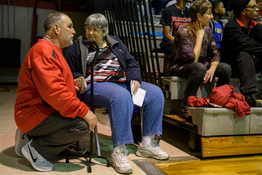 """Tommy Garrett, left, chats with Sandra """"Sam"""" Hunter, right, as they watch the Bosse Bulldogs take on the Castle Knights in the first round of the SIAC tournament at Bosse High School in Evansville, Ind., Wednesday evening, Jan. 15, 2020. Hunter thanked Garrett for moving her chair closer to the bleachers as the gym became packed with people."""