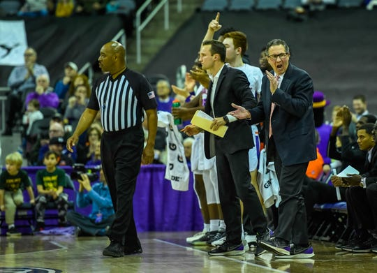 Evansville's head coach Todd Lickliter tries to rally the troops from the bench as the University of Evansville Purple Aces play the Drake Bulldogs, the first game under new Aces head coach Wednesday afternoon at the Ford Center, January 22, 2020.