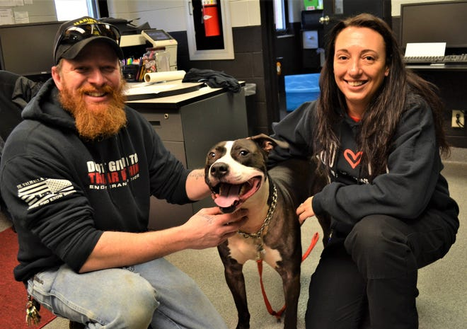 Marine veteran  Geoffrey Young became the first vet to obtain a dog through The Alpha Project at the Sandusky County Dog Kennel. Here, he poses with his dog Jackson and Kelly Askins, who created the program in an effort to honor vets.