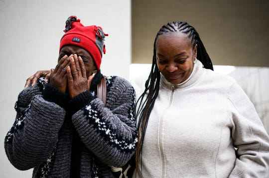 Regina Richardson comforts Barbara Smith while she attempts to speak about the life of La'Monte Marquise Simmons, after Rashad Jamon Stovall's bond hearing Thursday, Jan. 23, 2020.