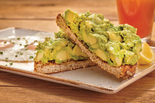 This submitted photo from First Watch shows the brunch spot's avocado toast, which comes on thick-cut whole grain bread alongside two eggs and a lemon wedge for $10.59, according to the restaurant's menu.
