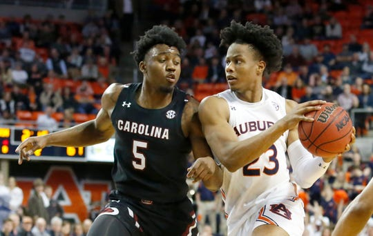 Auburn forward Isaac Okoro (23) goes to the basket as South Carolina guard Jermaine Couisnard (5) defends during the second half at Auburn Arena Wednesday night in Auburn, Ala.