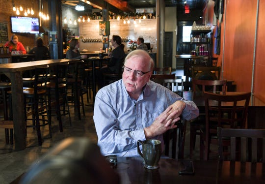 Don Herriott, owner of Brews on the Alley, talks about Seneca is a growing area and lives up to the county slogan the Golden Corner in Oconee County, during an interview at the pub.