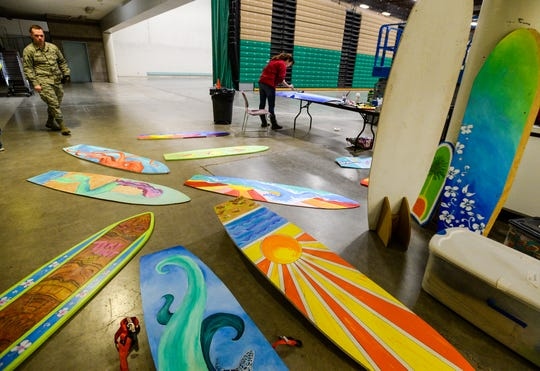 Hand painted mock surf boards will wait to be hung during the set up for the Margarita Meltdown on Wedensday afternoon.  The Margarita Meltdown, a fundraiser for Eagle Mount, starts at 5:30 p.m. on Friday, January 24.