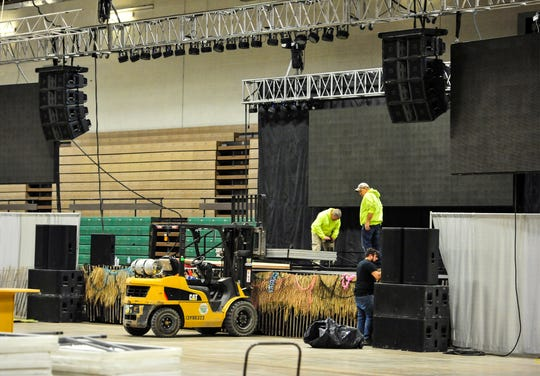 Workers set up the Margarita Meltdown stage Wednesday afternoon in the Four Seasons Arena.  The fundraiser for Eagle Mount starts at 5:30 p.m. on Friday, January 24.