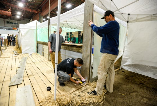 Volunteers set up cabanas for the Margarita Meltdown, Wednesday afternoon in the Four Seasons Arena.  The fundraiser for Eagle Mount starts at 5:30 p.m. on Friday, January 24.