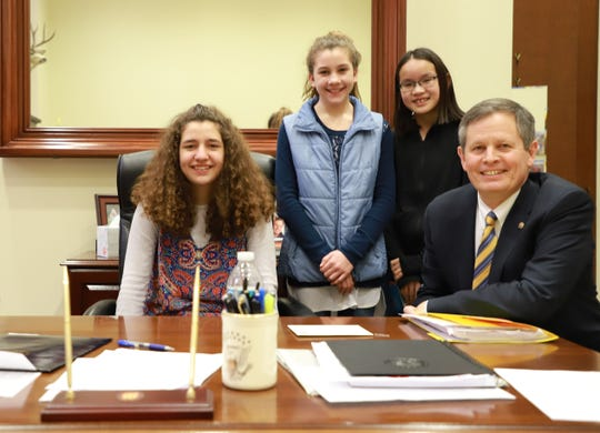 Sen. Steve Daines meets Thursday with, from left, Naomi and Sarah Espinoza and Emma Anderson, three girls involved with Espinoza vs. Montana Department of Revenue case now before the U.S. Supreme Court.