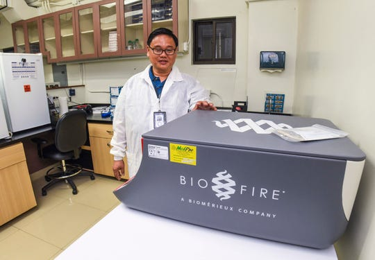 Alan Mallari, a microbiologist with the Department of Public Health and Social Services, describes the capabilities of the agency's new BioFire FilmArray System installed, but awaiting calibrations, in the Polymerase Chain Reaction Testing Laboratory at the Ran-Care Commercial Building, formally the Cen-Tam building, on Thursday, Jan. 23, 2020. The health department has relocated the lab's operation to the new location in Tamuning, due to an electrical fire that erupted its former Mangilao facility, November last year. The machine has the ability to test for infectious diseases, including dengue fever and coronaviruses, Mallari said.