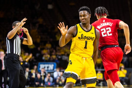 Iowa guard Joe Toussaint (1) waves towards the Rutgers bench after making a 3-point basket during a NCAA Big Ten Conference men's basketball game, Wednesday, Jan. 22, 2020, at Carver-Hawkeye Arena in Iowa City, Iowa.