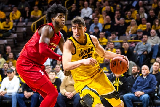 Luka Garza, driving on Rutgers center Myles Johnson last week, has moves he worked on all summer that he hasn't even shown yet, said his father, Frank. The Iowa junior center has shown plenty so far, spurring talk of national player of the year honors.