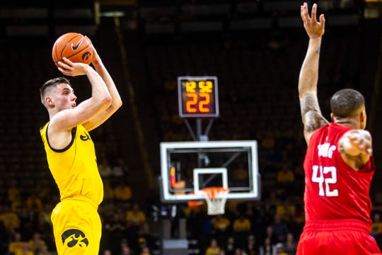 A lot was missing for Iowa in its first game against Nebraska this winter. The Hawkeyes missed 29 3-pointers in that 76-70 loss in Lincoln on Jan. 7. They also missed CJ Fredrick (pictured shooting over Rutgers' Jacob Young), who was out with an injury. Fredrick, the most accurate 3-point shooter in the Big Ten Conference, will be back in the lineup for Saturday's 5 p.m. rematch at Carver-Hawkeye Arena.