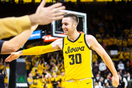 Iowa guard Connor McCaffery (30) high-fives fans during a NCAA Big Ten Conference men's basketball game, Wednesday, Jan. 22, 2020, at Carver-Hawkeye Arena in Iowa City, Iowa.