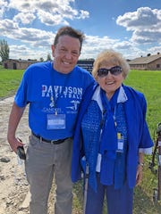 Alex Kor stands with his mother, Eva Kor, at the location of Eva's barrack at Auschwitz Birkenau in July 2018.