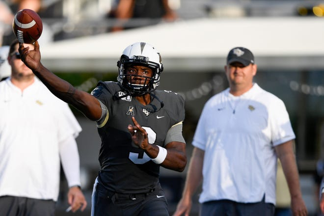 UCF Knights quarterback Brandon Wimbush (3) warms up prior to the game against the Florida A&M Rattlers at Spectrum Stadium.