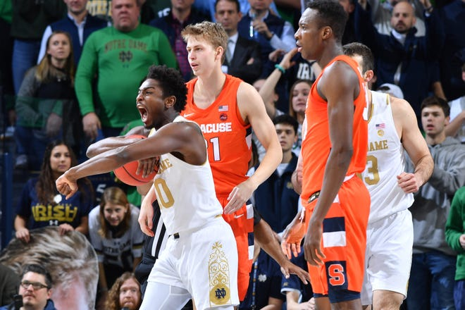 Jan 22, 2020; South Bend, Indiana, USA; Notre Dame Fighting Irish guard T.J. Gibbs (10) reacts after being awarded possession on a jump ball in the second half against the Syracuse Orange at the Purcell Pavilion.