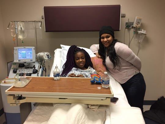 Nakaliyah, 12, and her mother Mikayla Robinson pose for a photo, Thursday, Jan. 23, 2020, at the DeGowen Blood Bank, where Nakaliyah gets regular blood transfusions to treat sickle cell disease.
