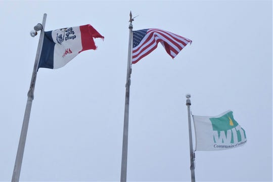 Flags fly on a windy day at Western Iowa Tech. President Terry Murrell denies claims that the community college lured foreign students to the United States with false claims so they could be used as cheap labor in local factories.