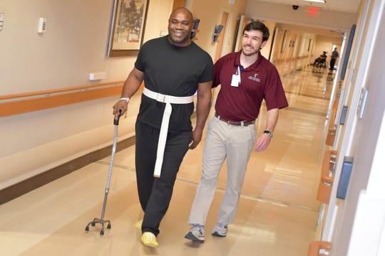 After being temporarily paralyzed by a spinal cyst, Ed Thigpen was delighted to be able to practice walking again with Methodist Rehabilitation Center physical therapist Kollin Cannon. Thigpen went from barely able to stand on shaky legs to meeting his goal to walk out of the Jackson, Miss., facility on Jan. 22, 2020.