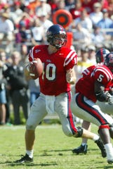 Former Ole Miss quarterback Eli Manning gets ready to throw in his college days with the Rebels.