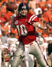 Former Ole Miss quarterback Eli Manning throws at the 2004 Cotton Bowl. (Photo courtesy Ole Miss Athletics)
