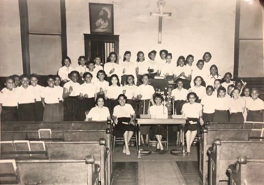 This photo of young girls holding candles up in a church has no date, but Annie Jones estimates it to be from the late 1950s. Jones is former YWCA Phyllis Wheatley Center executive director.