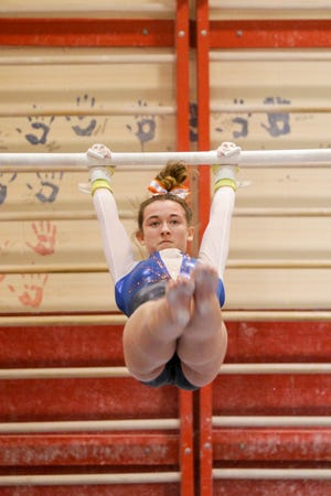 Harrison's Mia Clark competes on the uneven bars during an IHSAA gymnastics meet, Wednesday, Jan. 22, 2020 in Lafayette.