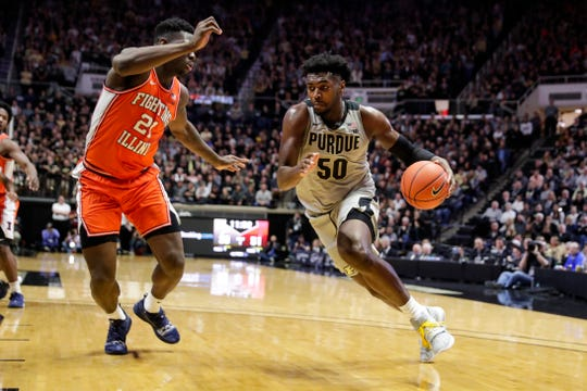 Purdue forward Trevion Williams (50) drives on Illinois center Kofi Cockburn (21) during the second half of an NCAA college basketball game in West Lafayette, Ind., Tuesday, Jan. 21, 2020. Illinois defeated Purdue 79-62. (AP Photo/Michael Conroy)